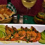 Fresh Jumbo shrimp in a parsley and garlic sauce.