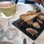 Glass of Chardonnay and selection of pates and terrines