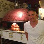 Handsome Franco & his famous brick oven ~