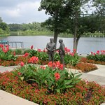 Some nice flower beds and statue along the lake