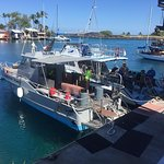 Our dive boat behind the first boat and the first rate crew getting ready