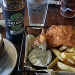 Fish and chips, mushy peas, and Crabbie's
