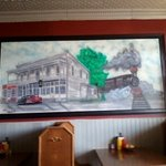 This is a hand drawn picture of the Inn on the wall in the room we ate in.