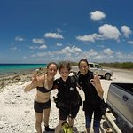 Amy, me, and a friend after diving on the Helma Hooker