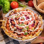 Spezi Plate with Meat,Sauce, Fries and salad
