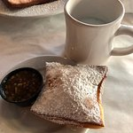 Cappuccino and beignet with praline sauce