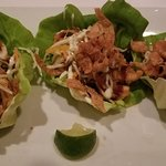 Shrimp and lettuce wrap with picked veggies and thin wonton crisps.  Knock your socks off delici