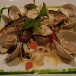 Bronzino fish with clams entree.  Crispy skin on fish was mild and nice.  House made noodles wer