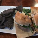 Tuna on a bagel, with blue corn chips