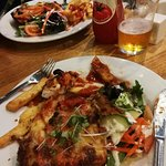 Traditional Chicken Parma with chips and salad