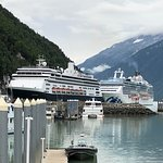 Picture of our Zodiac raft next to pier in front of large cruise ships.
