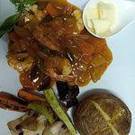 Regular Steak with Roasted Vegetables and Chips.Hot and Spicy Langoustines with Jacket Potato an