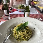 Spaghetti with basil pesto, pine nuts and parmesan