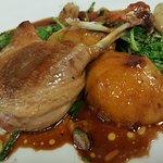 Duck Confit, Brandy Peaches, Frisée, Pistachios, Pearl Onions