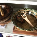 Ornate wood bowls for sale (and a wood toy top displayed inside each bowl)