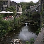 Photo of Ambleside, with The Giggling Goose Cafe outside seating area to the left