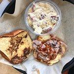 A huge portion of slaw upstages the brisket sandwich.