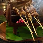 Satay is served on a little table top charcoal grill...very cute