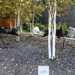 """Rachelle Dowdy's sculpture """"Ravens in Nails"""" outside the center"""