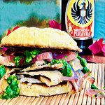 pork sandwich with original recipe chimichurri and pickled onions