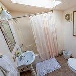 Eyebrow Room bathroom with skylight which opens