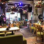 Small restaurant with song and music