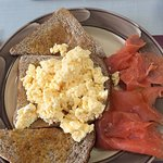 Scrambled eggs and smoked salmon on brown bread