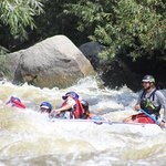 Ethan guides the raft through a class IV rapid