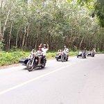 Side-car takes you though rubber plantation