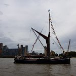 Similar Thames barge passing