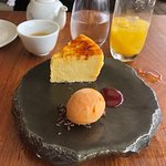 Nobu cheesecake served with peach sorbet and sour cherry reduction.