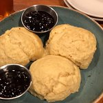 Beautiful homemade biscuits with honey or blueberry compote.