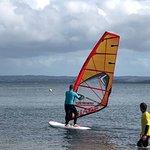 Me windsurfing, and Jonathan instructing.