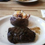 Marinated steak with loaded baked potato