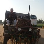 Guest From France enjoying the ride Local vehicle ( Village, Dasada, Gujarat )