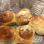 Rolls topped with Parmesan Cheese