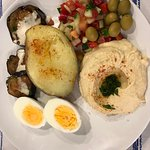 Meal with potato, hummus and eggs