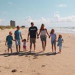 Family enjoying beach area