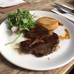 Steak (150g grass fed scotch fillet, potato fondant, café de paris butter, beef jus, herb & leaf