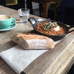 Cassoulet(smoked ham hock, pork sausage, bacon, beans, herb crumb, fried egg & baguette)