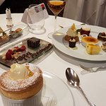 Two desserts - one a passion fruit souffle. the other a selection of the chef's favourites