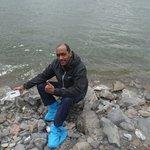sitting on stones next to the lake