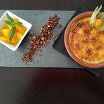 Creme Brulee served with a chocolate crunch and a orange compot
