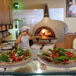 Freshly made pizza right in front of you