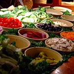 Salad bar with fresh vegetables, fresh bread and cheese