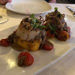 Scallops on bed of polenta with porcini mushrooms.