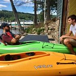 Staff member (R) giving kayak instructions