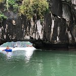 Kayaking in Ha Long Bay by a floating village