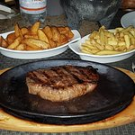 Sirloin steak on sizzling plate