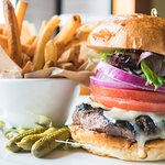Our Classic Cheese Burger - 10oz Angus on a fresh baked roll with fresh cut fries